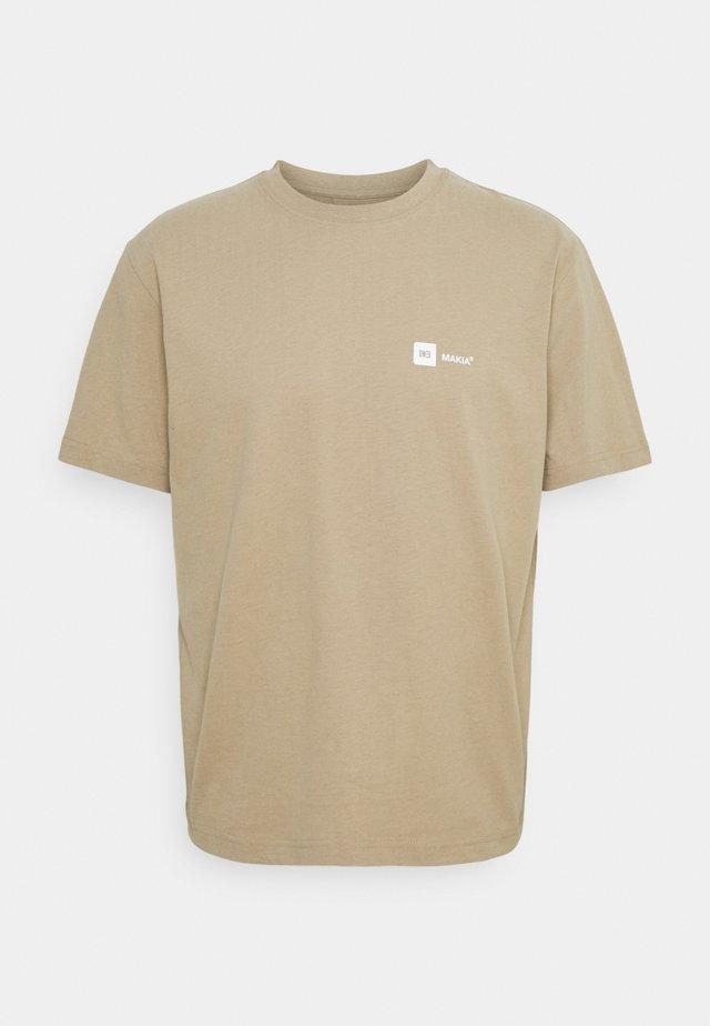 DYLAN - T-shirts med print - beige
