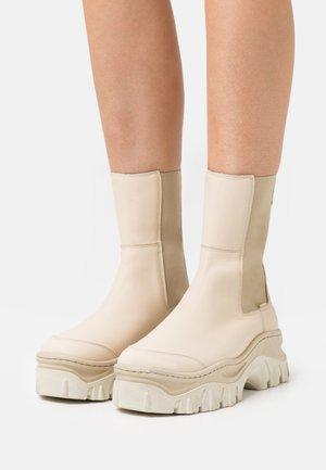 JAXSTAR - Platform ankle boots - camel