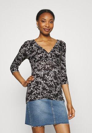 TRILLE TESS - Print T-shirt - black