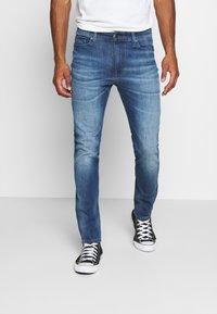 Tommy Jeans - SIMON SKINNY - Skinny-Farkut - blue denim - 0