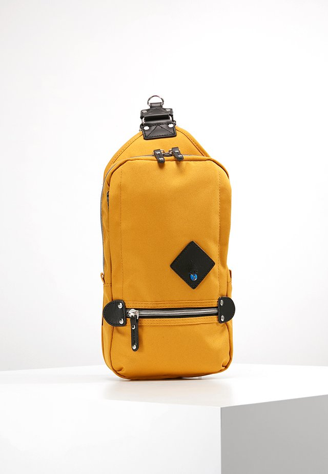 TAKAO - Across body bag - yellow