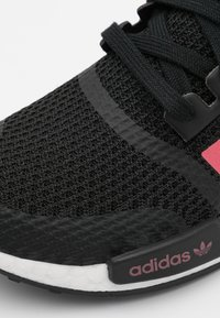 adidas Originals - NMD_R1 BOOST SPORTS INSPIRED SHOES UNISEX - Sneakers - core black/signal pink/footwear white - 5