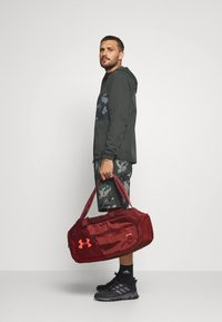 Under Armour - UNDENIABLE  - Sports bag - cinna red - 0