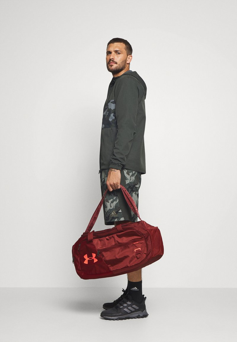 Under Armour - UNDENIABLE  - Sports bag - cinna red