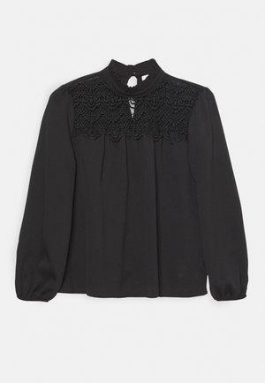 RUFFLE NECK YOKE - Button-down blouse - black