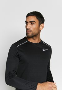 Nike Performance - DRY MILER - Sports shirt - black/silver - 2