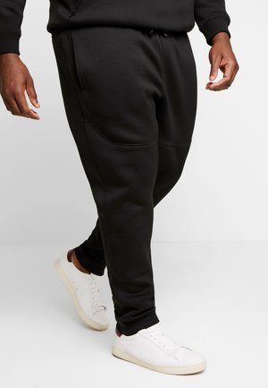 CUT AND SEW PLUS SIZE - Tracksuit bottoms - black