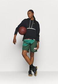 Nike Performance - STANDARD ISSUE - Sweatshirt - black - 1