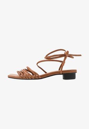 ANNI - Sandals - saddle