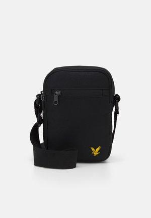 REPORTER BAG - Across body bag - true black