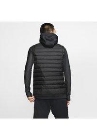 Nike Performance - THERMA - Waistcoat - black/dark grey - 2