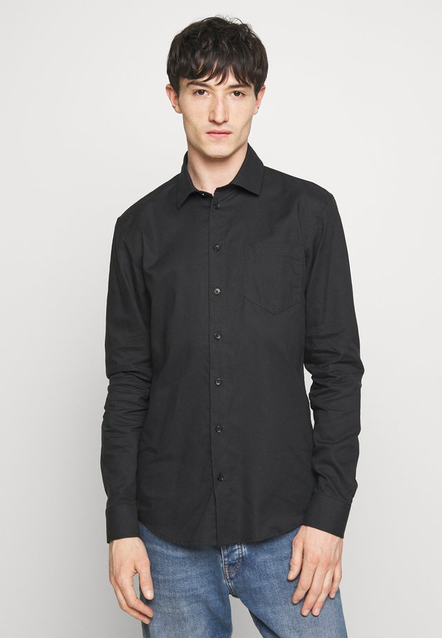 ANTON CLAUS - Shirt - black