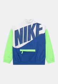 Nike Sportswear - PACKABLE WIND  - Training jacket - lime glow - 1