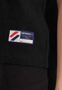 Superdry - Print T-shirt - black - 1