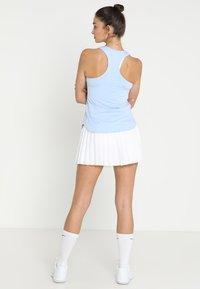 Nike Performance - VICTORY SKIRT - Sports skirt - white/black - 2