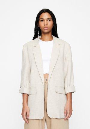 Korte frakker - beige