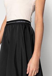 Calvin Klein Jeans - LOGO ELASTIC SKIRT - Mini skirt - black - 4
