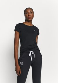 Under Armour - T-shirts basic - black - 0