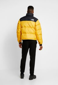 The North Face - Down jacket - yellow - 2