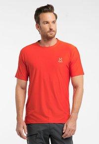 Haglöfs - L.I.M TECH TEE - Print T-shirt - orange - 0