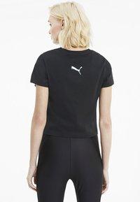 Puma - EVIDE GRAPHIC TEE - T-Shirt print - black - 2