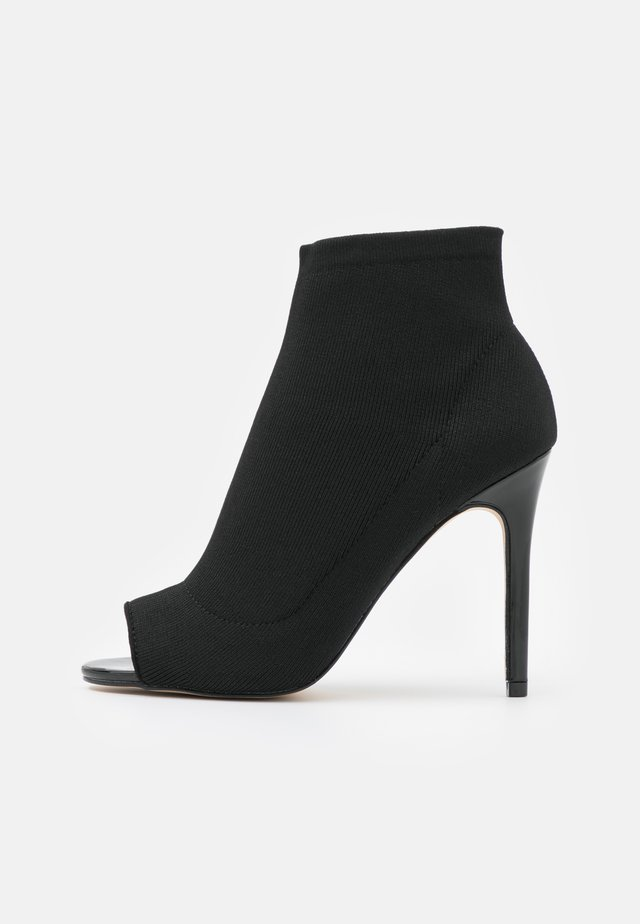 STILETTO - High heeled ankle boots - black