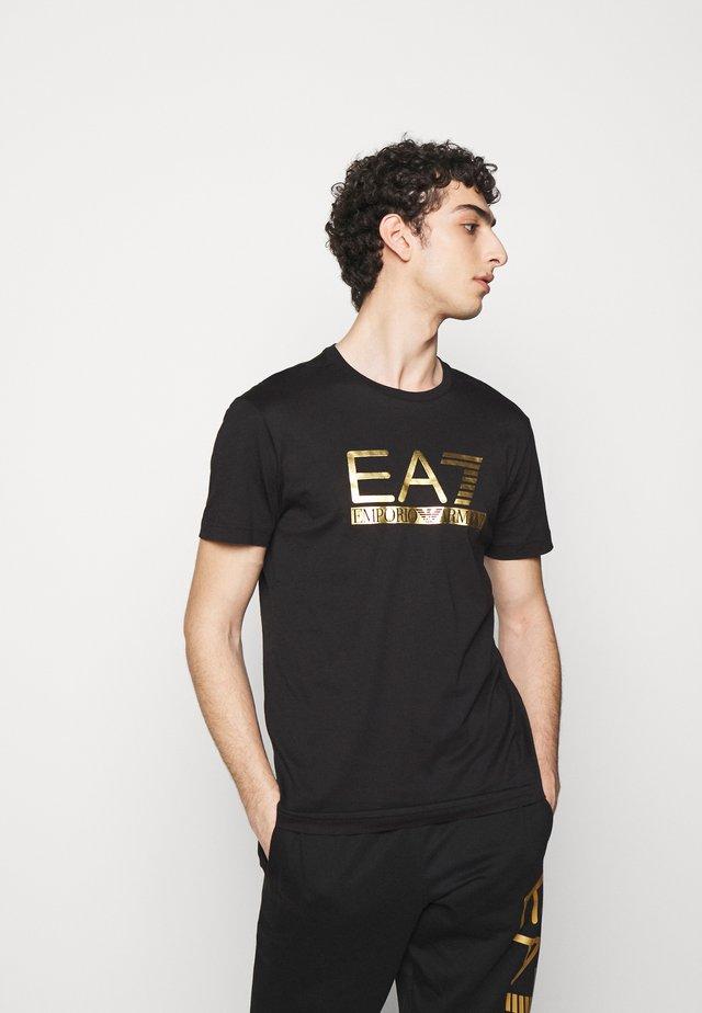 T-shirt imprimé - black/gold