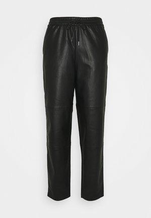 SIRASI VEGAN TROUSERS - Trousers - black