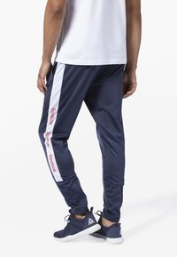 Reebok - TRAINING ESSENTIALS LOGO TRACKSTER PANTS - Tracksuit bottoms - blue - 2
