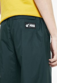 Puma - X THE HUNDREDS - Tracksuit bottoms - ponderosa pine - 4