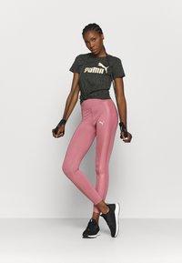 Puma - TEE - T-shirts med print - puma black - 1