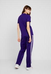 adidas Originals - FIREBIRD ADICOLOR TRACK PANTS - Verryttelyhousut - collegiate purple - 2