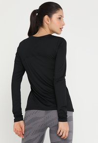 Nike Performance - ALL OVER - Sportshirt - black/white - 2