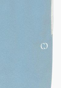 Criminal Damage - ORDINATE - Pantalon de survêtement - blue/reflective white - 3