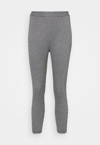 Leggings - Trousers - black/white