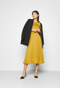 King Louie - DANNA PLISSE DRESS GINTY - Cocktail dress / Party dress - curry yellow - 1