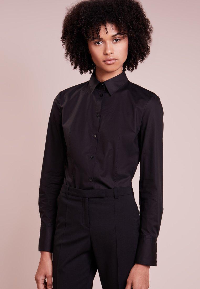 HUGO - ETRIXE - Button-down blouse - black