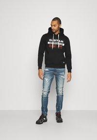 American Eagle - DESTROY - Slim fit jeans - effortlessly cool - 1