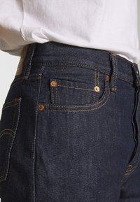 Levi's® - Jeans straight leg - across a plane - 4