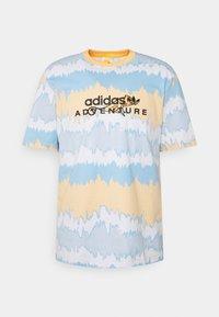 UNISEX - Print T-shirt - hazy orange/multicolor