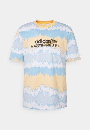 UNISEX - T-shirt imprimé - hazy orange/multicolor