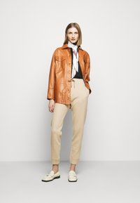 Bally - LUX TRACK PANTS - Tracksuit bottoms - camel - 1