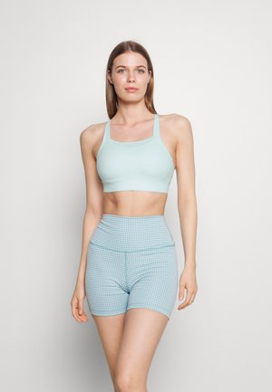 LUXE BRA - Medium support sports bra - teal tint/barely green