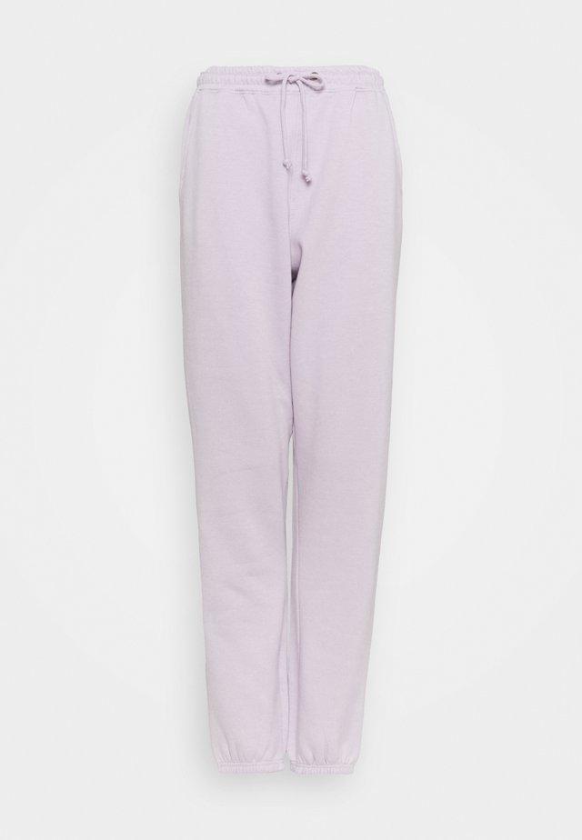 JOGGERS - Tracksuit bottoms - purple