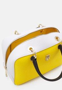 Tommy Hilfiger - ESSENCE DUFFLE - Handbag - yellow - 2
