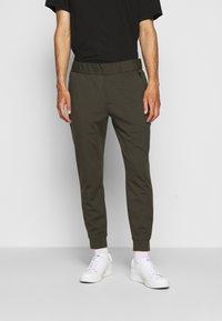 Emporio Armani - JEZZ - Trousers - dark green - 0