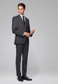 BOSS - GENIUS5 - Suit trousers - dark grey - 1