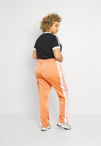 adidas Originals - ADIBREAK - Tracksuit bottoms - hazy copper - 2