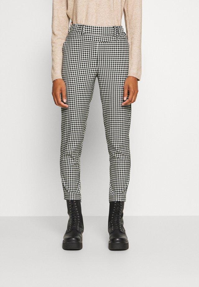 KATERNE 7/8 PANTS - Kalhoty - black/white