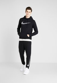 Nike Performance - DRY HOODIE - Jersey con capucha - black - 1